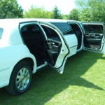 white-limo-door-open-on-grass