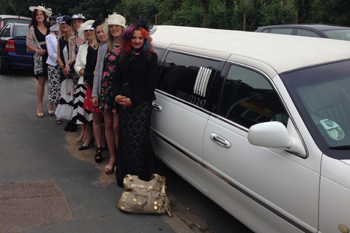 white-limo-taking-ladies-to-the-races