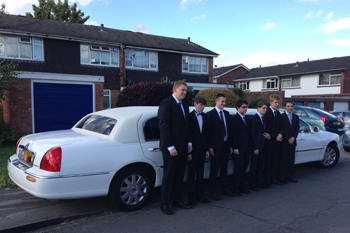 white-limo-with-boys-in-suits