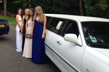 white-limo-with-girls-dressed-up-on-drive-ready