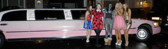 wide-image-christmas-limo-pink-limo-snowing