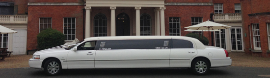 wide-image-white-limo-on-house-driveway
